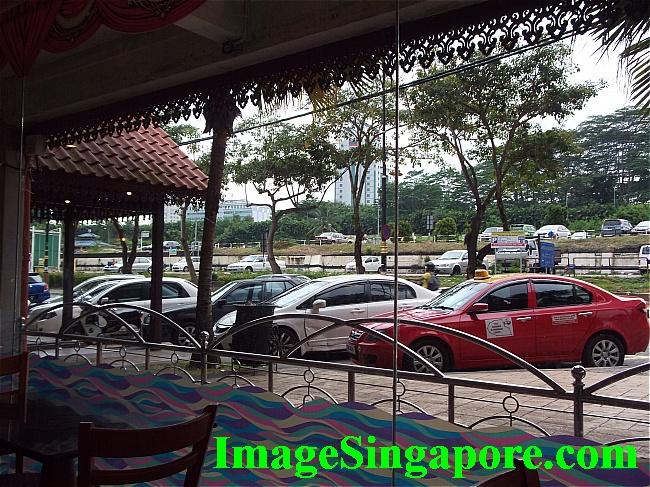 Spacious car park outside Amma restaurant.