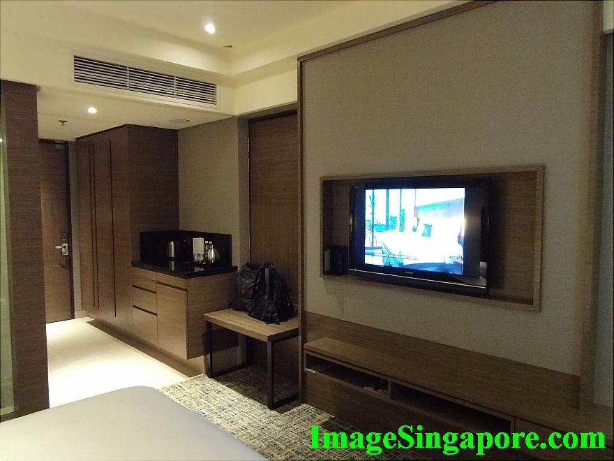 Spacious room with large TV