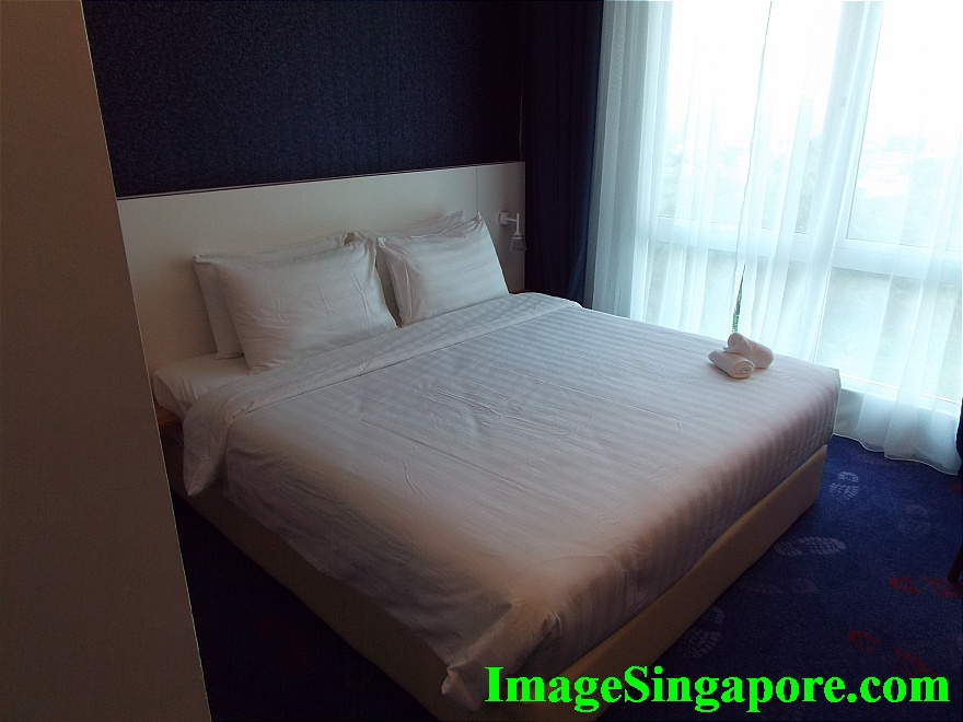 This is the Deluxe King Size bedroom at Amerin Hotel